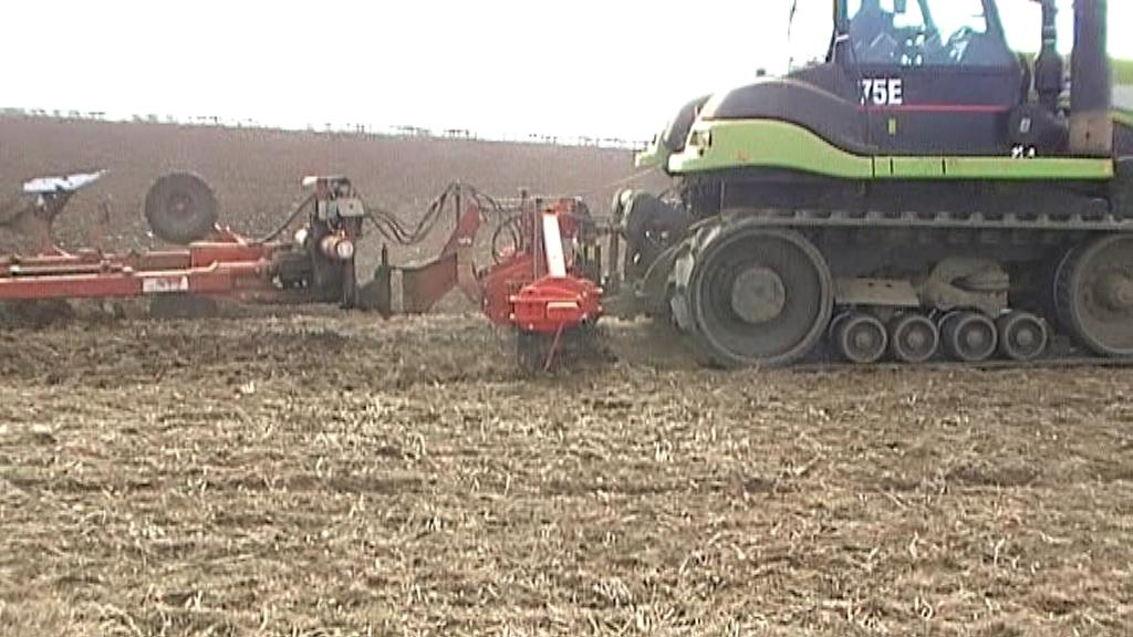 SCD with 8 furrow semi mounted plough
